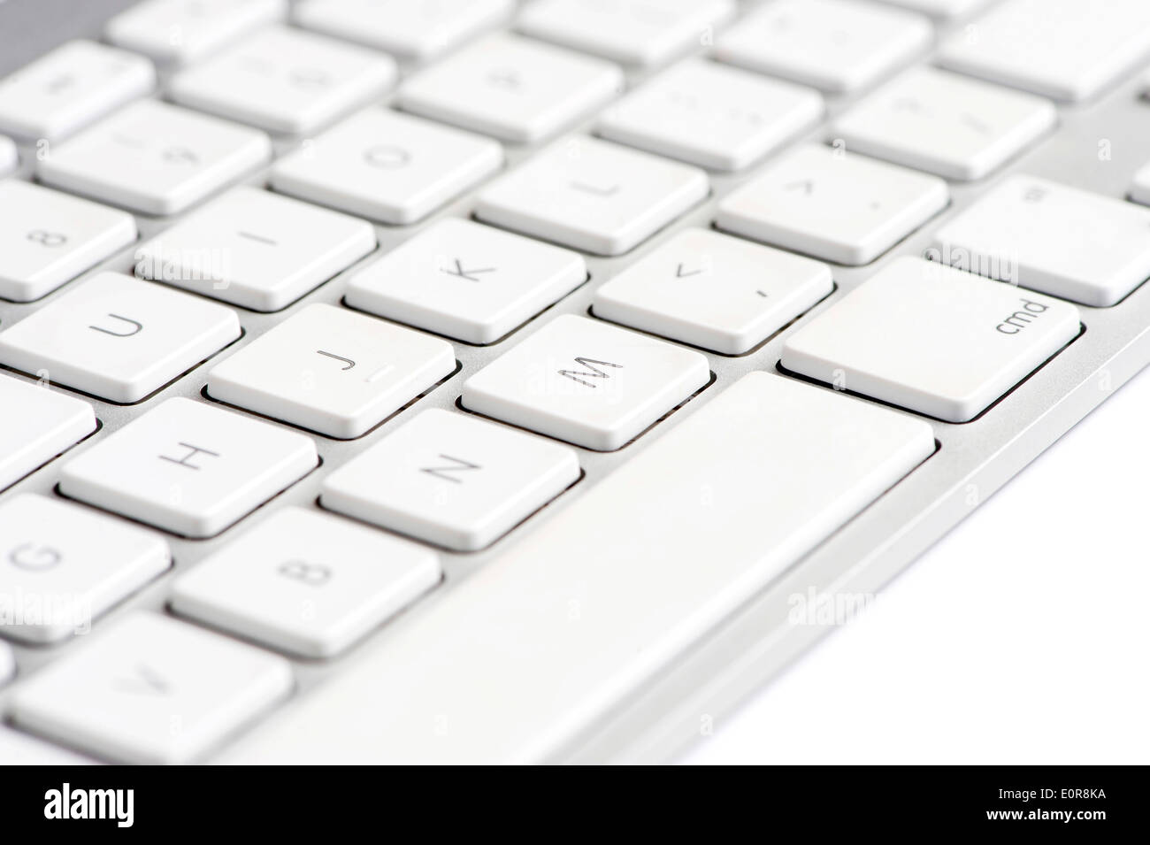 Apple mac white Keyboard focused on the letter M - Stock Image
