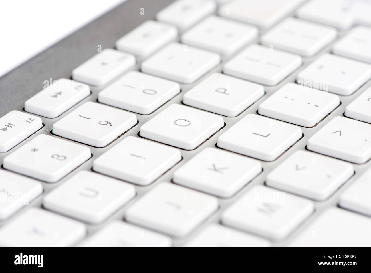Apple mac white Keyboard focused on the letter O - Stock Image