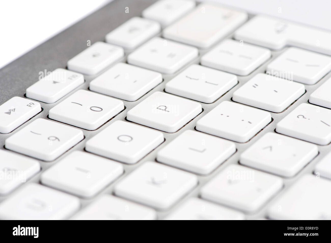 Apple mac white Keyboard focused on the letter P - Stock Image