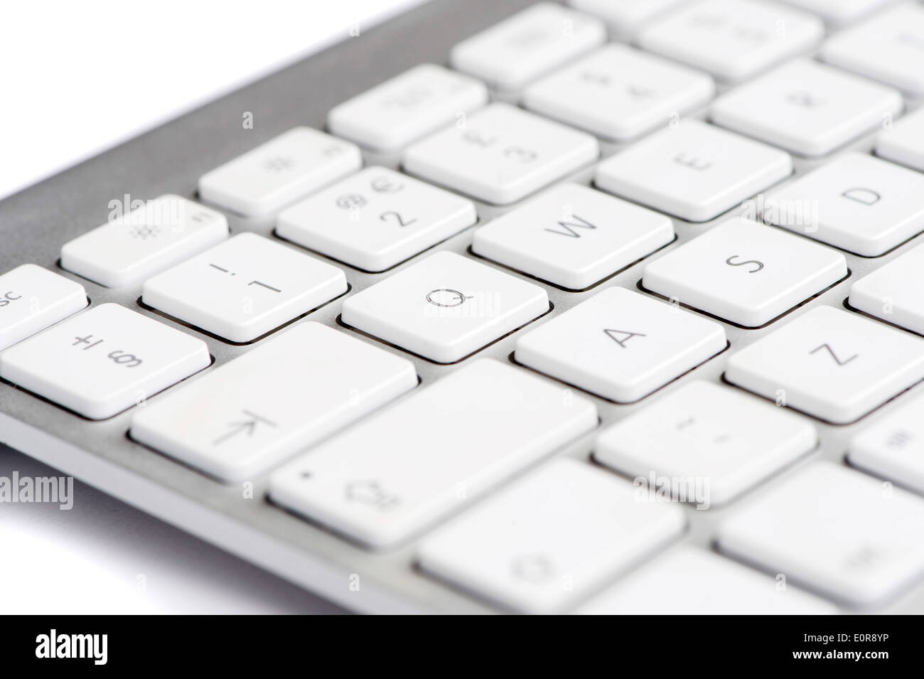 Apple mac white Keyboard focused on the letter Q - Stock Image