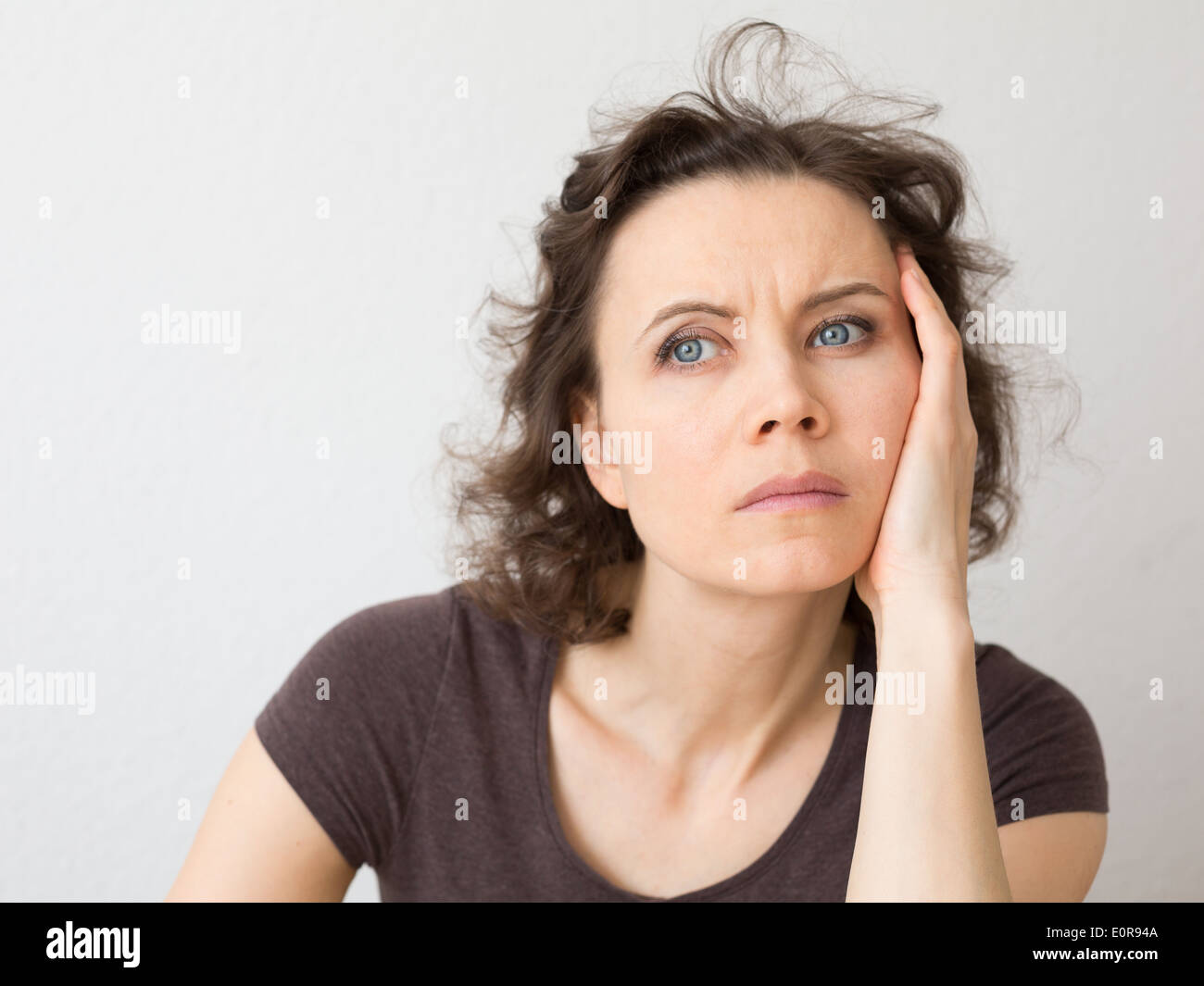 Woman thinking about seriously Stock Photo