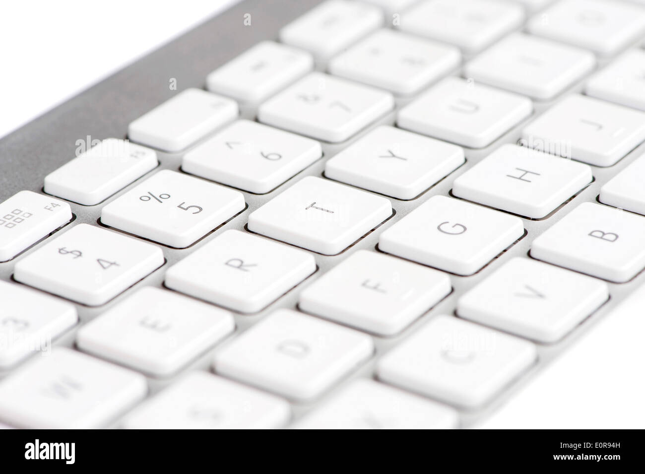 Apple mac white Keyboard focused on the letter T - Stock Image