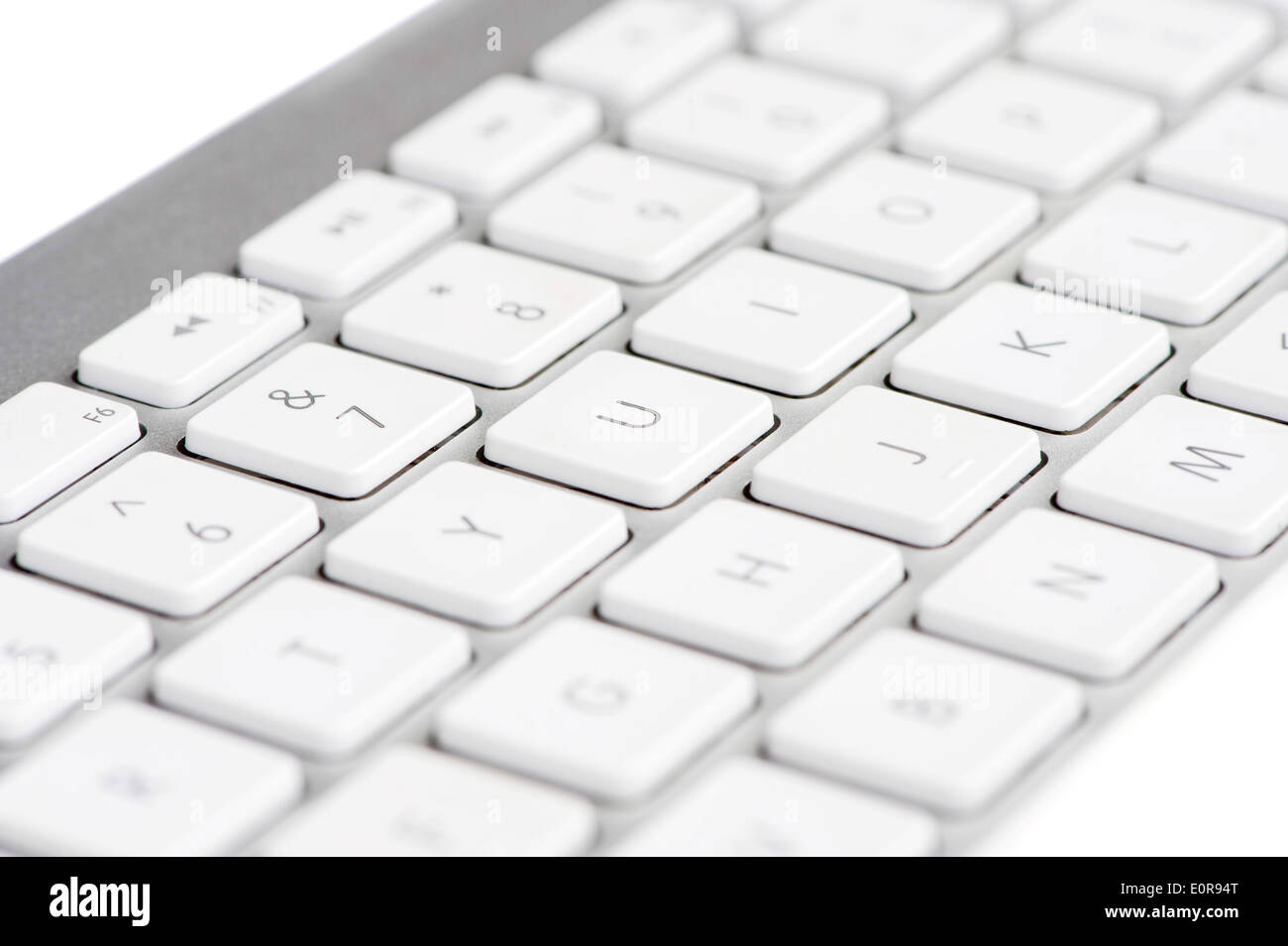 Apple mac white Keyboard focused on the letter U - Stock Image