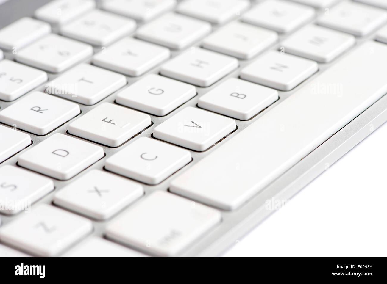 Apple mac white Keyboard focused on the letter V - Stock Image