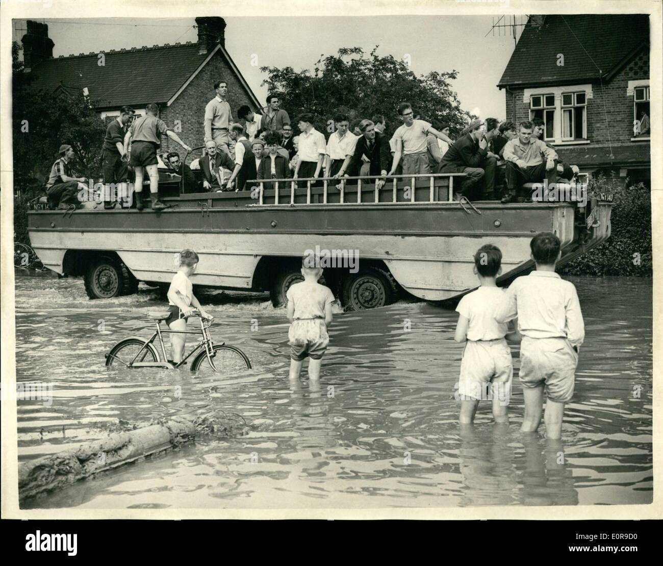 Sep. 09, 1958 - Flood Scenes after last night's storm. Much damage was caused last night in what was described as ''one of the most spectacular storms of the century'', which swept the south of England. Many housed were flooded and buildings damaged. Photo shows A.D.U.K.W. which was brought into action convey people about in flooded wickford, Essex, today. - Stock Image