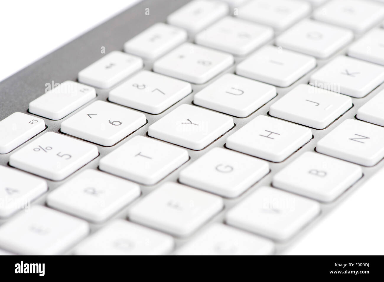 Apple mac white Keyboard focused on the letter Y - Stock Image
