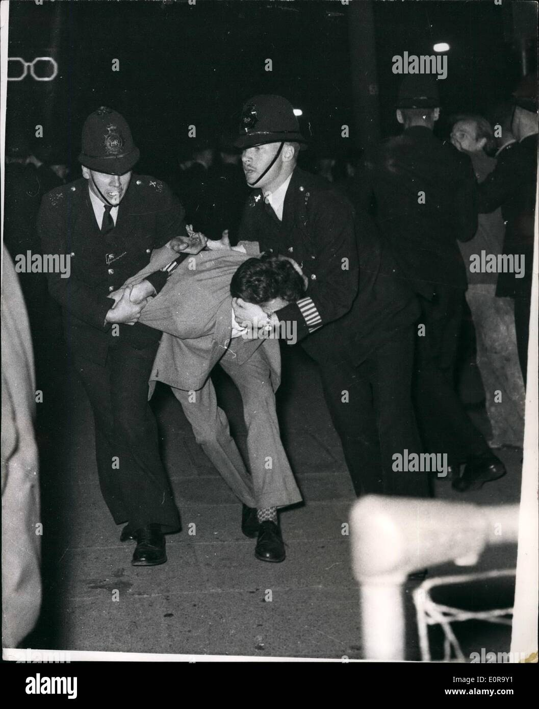 Sep. 09, 1958 - Black-White Racial Riots Once Again In Notting Hill Gate.. Police Struggle With A Demonstrator. Many arrests were made in the Black - White racial riots which broke out again for the fourth night in succession at the Notting Hill Gate area of London. Keystone Photo Shows:- Policeman struggle with rioter - in Blenheim Crescent... Many arrests were made. - Stock Image