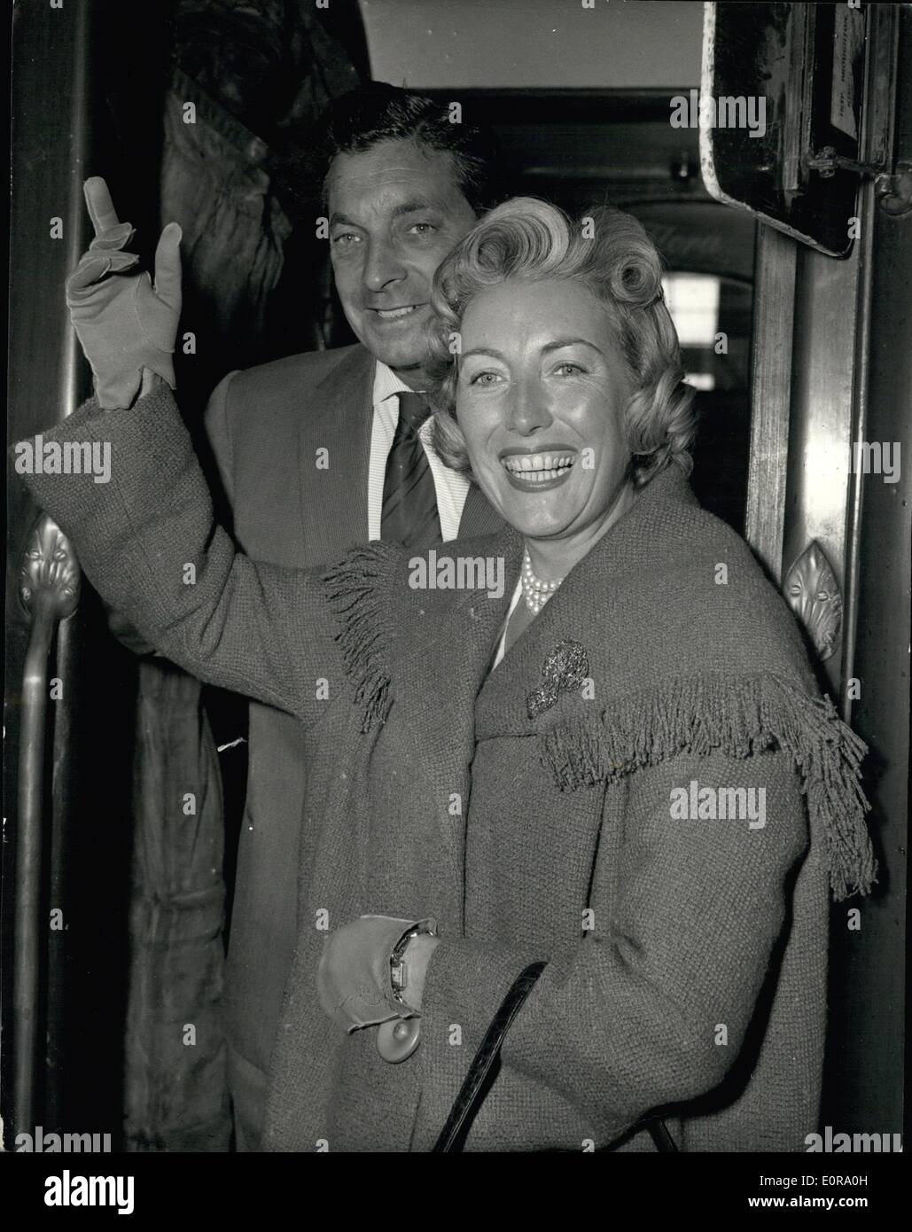 Sep. 09, 1958 - Vera Lynn Leaves For The United States. Photo shows Vera Lynn the popular British singer - and her husband Mr. Harry Lewis seen when they left Waterloo Station this morning on the s.s. Queen Elizabeth Boat Train for the United States. - Stock Image