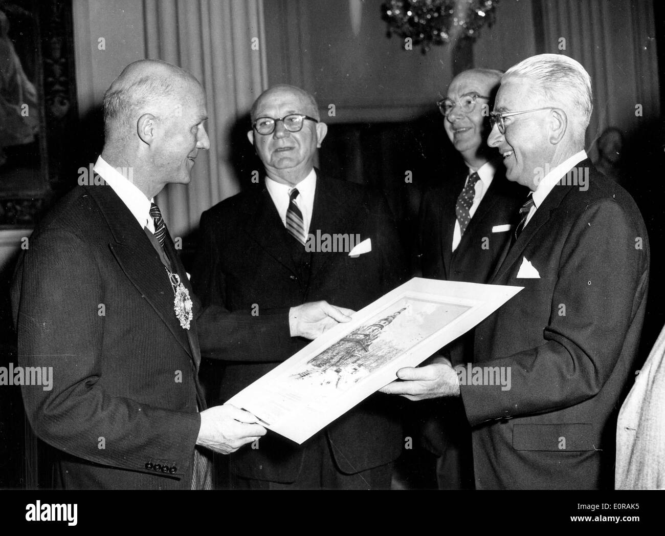 Sep 23, 1958 - London, England, UK - (File Photo) From left, Sir DENNIS TRUSCOTT, Lord Mayor of London, receives an etching from the U.S. city of Baltimore presented by EDWARD CORCORAN, CHARLES P. CRAIN, and AVERY W. HALL, at Mansion House. - Stock Image