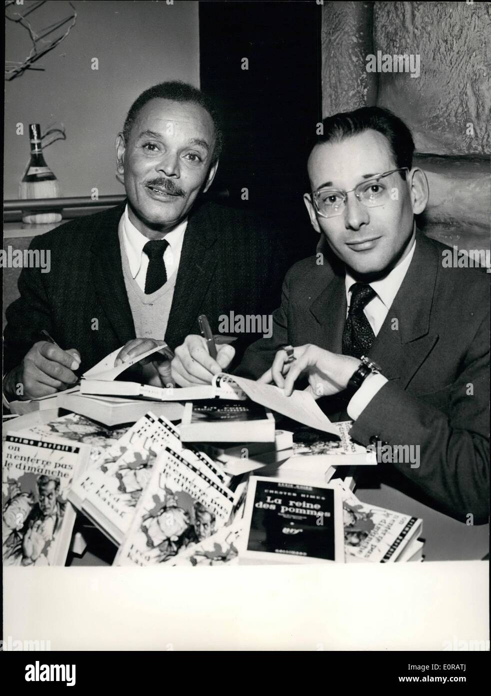 Nov. 11, 1958 - Authors Of Best Detective Stories Rewarded: French novelist Fred Kassak (right) and the American Chester Himes were each awarded the Grand Prix of Detective stories 1958 in Paris yesterday. Kassak is the author of ''On N'enterre pas Le Dimanche'' (No Funerals on Sunday) and Chester Himes is rewarded for his book ''The Apple Queen' - Stock Image