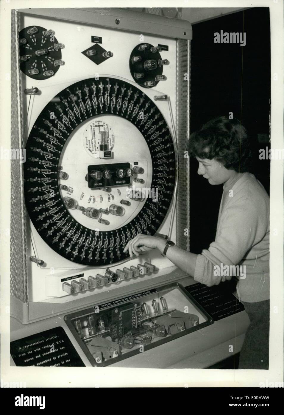 Nov. 11, 1958 - Radio Hobbies exhibition: The Radio Society of Great Britain's Radio Hobbies exhibition, opened today at the Royal horticultural old hall. photo shows Miss Carol Creagh, 18, of Leytonstone, checks her watch with an electronic clock. This clock is a working display to snow comprehensive collection today, on the standard telephone $ cable company's stand. - Stock Image