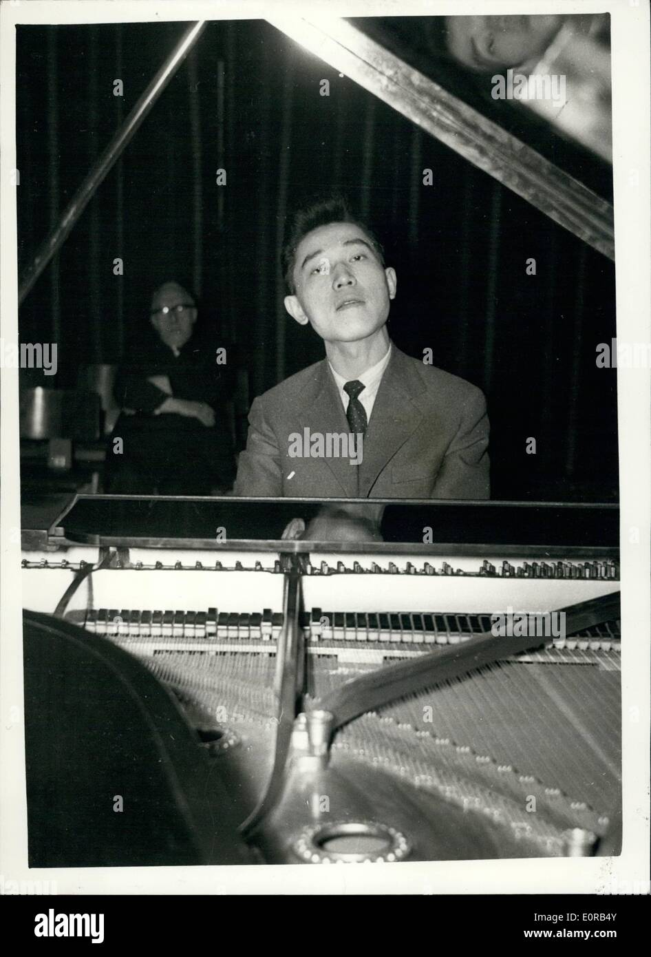 Dec. 12, 1958 - Chinese Pianist leaves hideout to give recital.: Chinese concert pianist Fou Ts'ong who is hiding in this country - having arrived from Poland last week - gave a concert before a few persons = at the Riyal Festival Hall last evening. Fou has refused an order from Peking to return to China - where, he says, he would be imprisoned. One attempt has already been made by 'red' agents to capture him in London. The agents were spotted outside the front entrance to a London hotel - and he was taken out by a side exit - and is now being carefully guarded - Stock Image