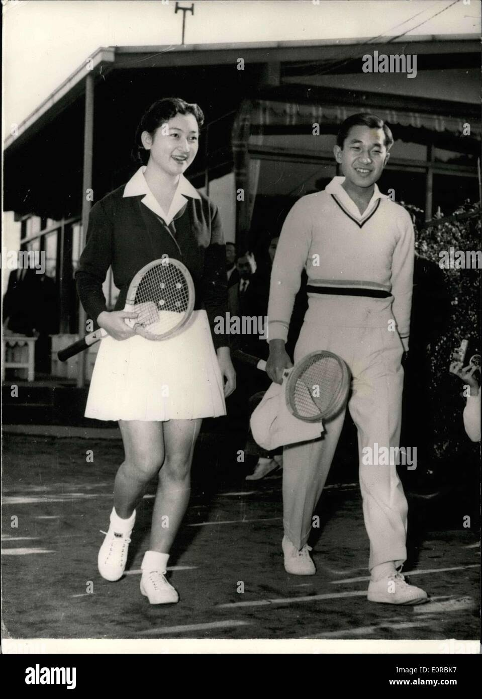Dec. 09, 1958 - Crown Prince Akihito and Fiancee play tennis: Crown Prince Akihito of Japan and his fiancee, Miss Michiko Shoda, partnered each other at tennis over the week-end at the Tokyo Lawn Tennis Club in Azabu, Tokyo. This was the first time they have been photographed together since the announcement of their engagement. Photo shows Crown Prince Akihito and his fiancee, Miss Michiko Shoda, seen on their way to the courts for their tennis game at Azabu, Tokyo. - Stock Image