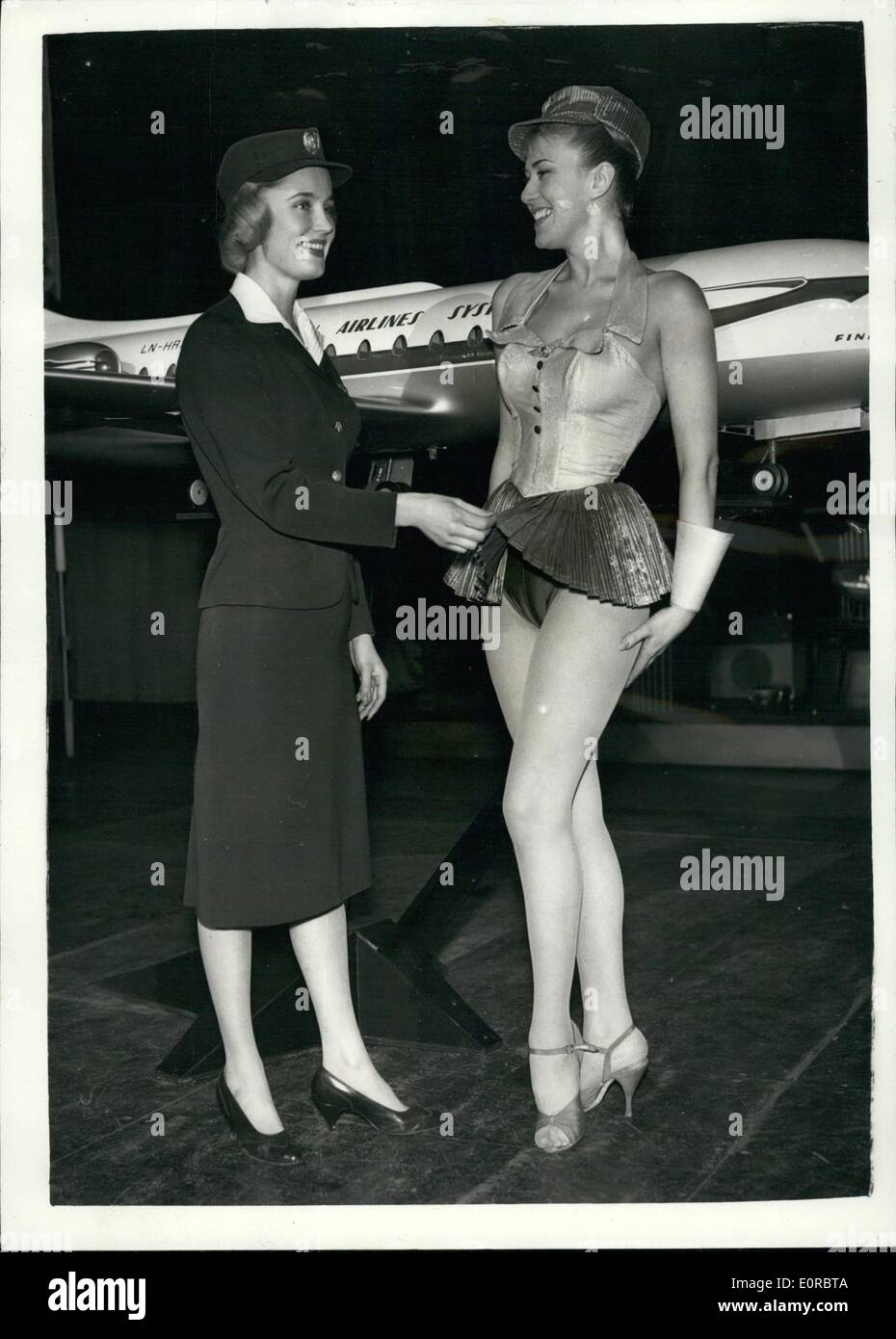 Jan. 01, 1959 - Scandinavians Air Hostesses in London. Show to laugh new services.: Four lovely Scandinavian air hostesses as were to be seen in London this afternoon rehearsing for the show at the ''Talk of the Town'' - which is being held to launch new services of the Scandinavian Air Lines. Part jet engines air liner. The show illustrates air services of the present and the future - Stock Image