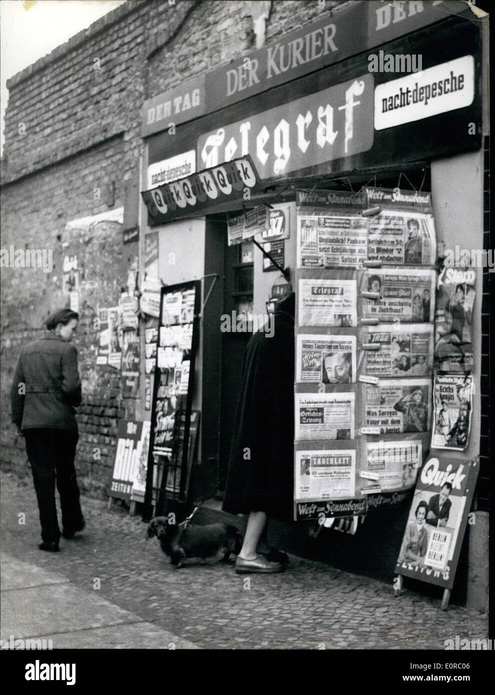 Dec. 12, 1958 - Children have to do spy service: The police of the east-zone of Germany ordered some 8 to 12 years old boys of east - Berlin to do spy service at the zone-border in Berlin to buy western-papers at te newspaper kiosk at the Bernauer-Wollinerstreet. Further the boys get a reward of 50 pennies when they can tell the east-zone police which people of east-Berlin buy newspapers there and return then to east-Berlin. Photo Shows: The newspaper-kiosk at the corner of the Wolliner and Bernauerstreet where the west-Berlin was forced on Dec - Stock Image
