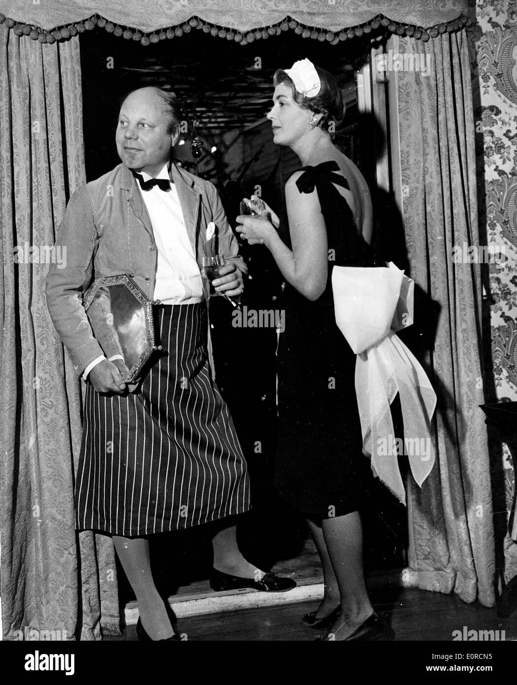 Jan 07, 1959; London, UK; JOHN SPENCER CHURCHILL and his wife as footman and maid arrive for the Mayfair Twelfth Night Party. - Stock Image