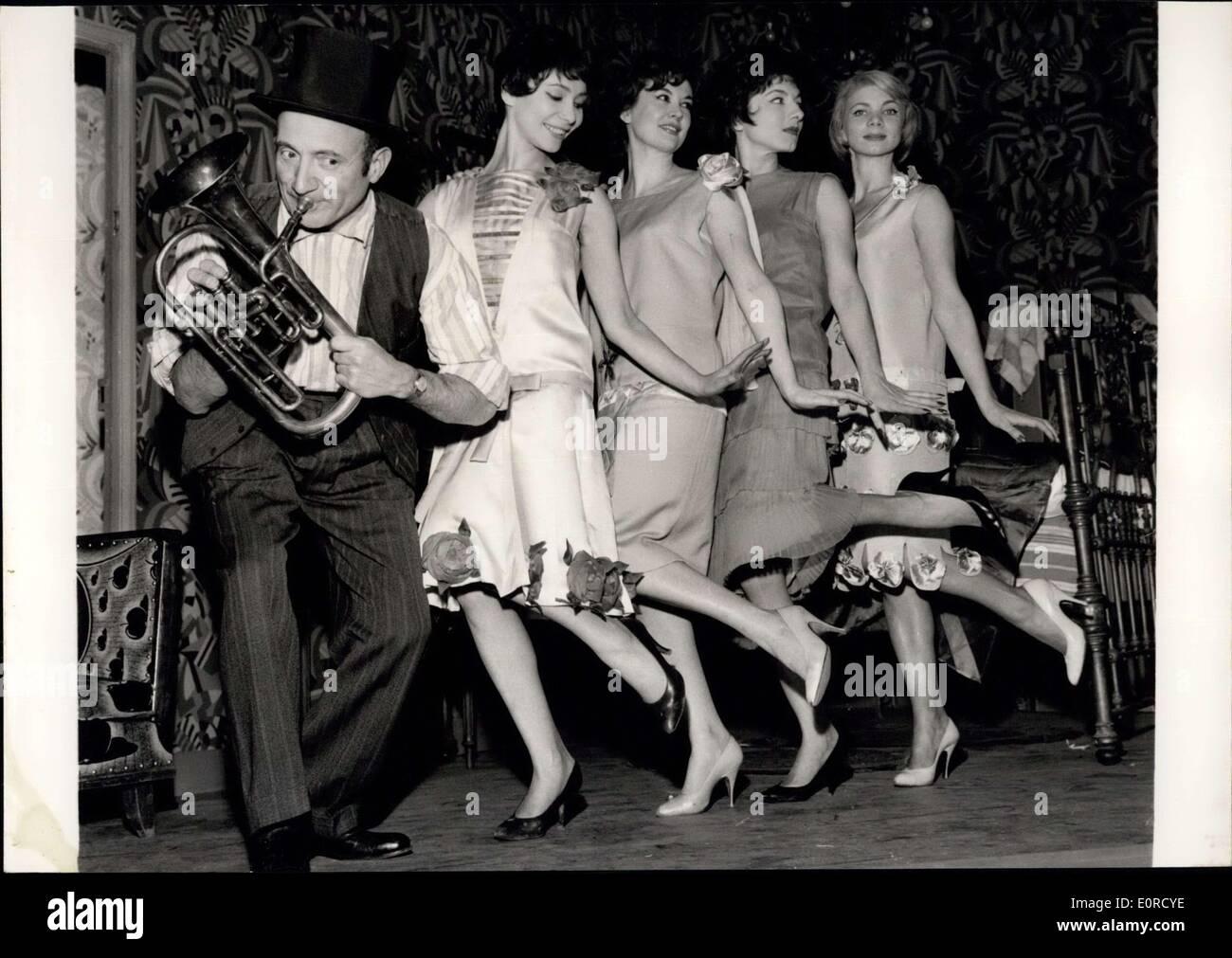 Jan. 20, 1959 - Top Hats Early Century Style In Fashion Again: But it is only on the stage. Olivier Houssenot, the well-known Paris stage producer is now showing ''The three Top-Hats'' a comedy by a Spanish playwright Miguel Mihura in French adaption. Photo shows Olivier Houssenot with four actresses appearing on the play who are seen dancing Charleston. - Stock Image