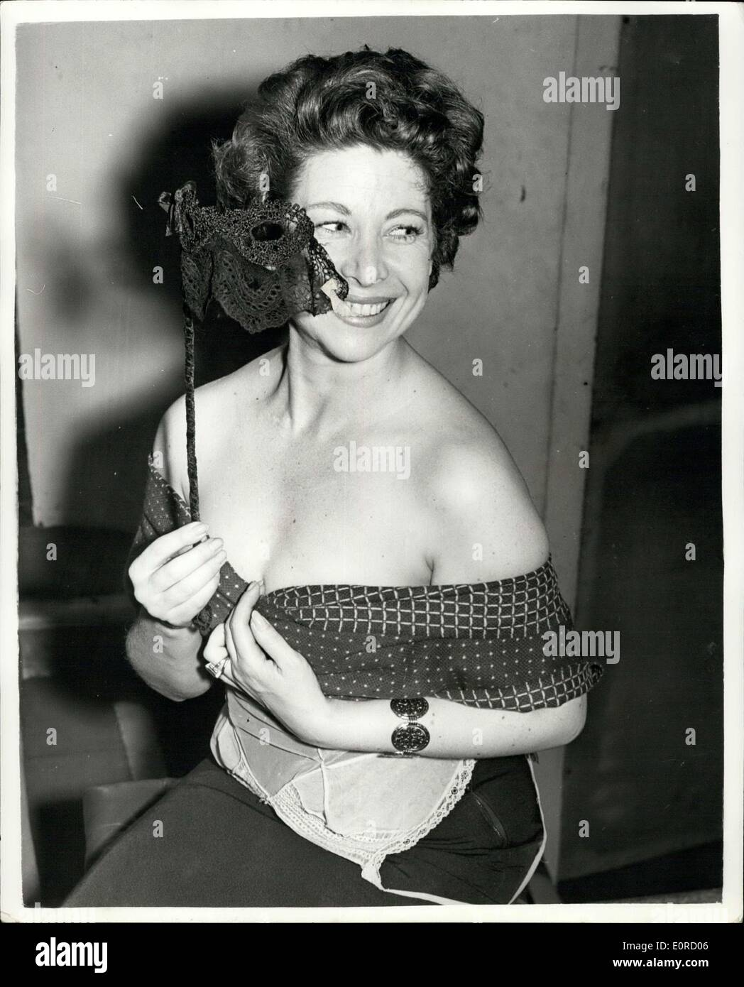 Jan. 22, 1959 - Behind a Masque she'll be the only woman at the new only Concert : Diane Dubarry, titian-haired, Stock Photo