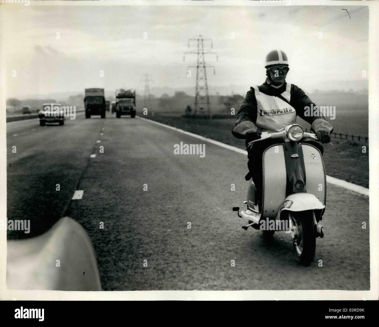 Feb. 02, 1959 - LAMBRETTA COVERS 142 MILES in 143 MINUTES ON THE NEW MOTORWAY,. BRIAN GIBBS, works rider for Lambretta, took a spare part to the Birmingham end of the new motorway opened today - the M.1 from Luton Spur, where the opening took place and returned after refuelling to the St. Albans, end of tie M.1, H. covered the total of 142 miles in 143 minutes,, KEYSTONE PHOTO SHOWS, BRIAN GIBES seen riding the Lambretta to Birmingham, on the '' today, - Stock Image