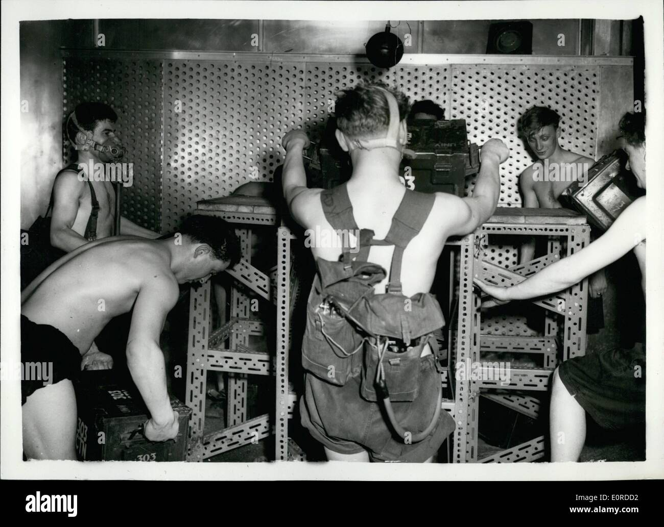 Mar. 03, 1959 - Army Personnel undergo ''Heat Test'': Volunteer Army Personnel are now undergoing a series of ''Heat Test'' at the Army Research Establishment at Hampstead. The tests include lifting 50 lb tailboards in a room with humidity temp of Dewpoint 84. This is carried out in four hour periods of 30 mins. break which includes recording periods . at the end of each period four men observers examine the volunteers condition of breathing pulse etc. Throughout each test the volunteers wear an IMP mask (Integrating Motor Pneumotachograph) which records breathing oxygen contents etc - Stock Image