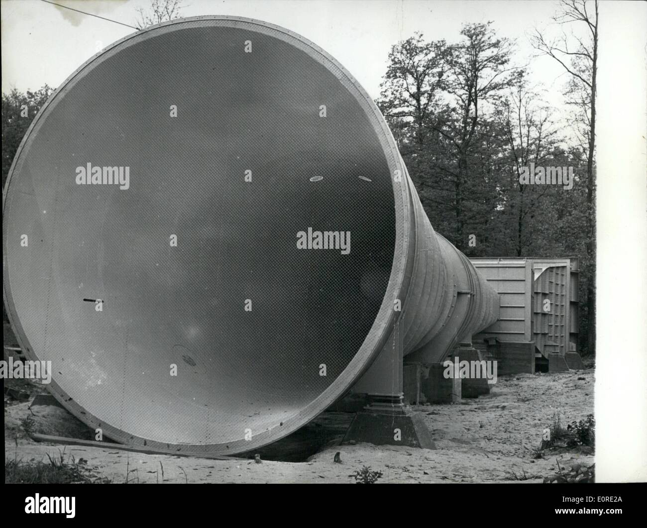 Feb. 02, 1959 - Making much wind: Like a monster of the prehistory this 40 meters long colossus in the 'Pfappen - wood' near Stuttgart. The wind tunnel with a diameter of 3 meters belongs to the 'Technical High School' of stuttgart to the institute of aero-gasdynamic. The research institute is just build up and will begin working in the autumn of this year. The costs will run to several millions. - Stock Image
