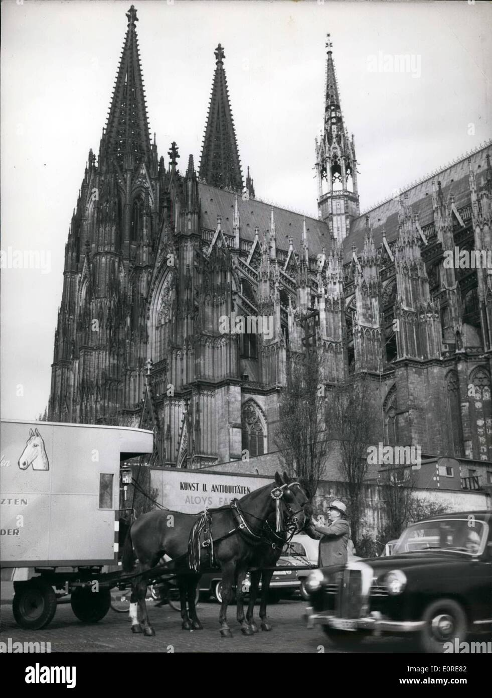 Apr. 04, 1959 - The last coachman of Cologne went on a long trip on April 7th. With his two horses, Dora and Merry he intends to go to Holland, Belgium, France, Spain, Portugal Italy and Austria. He has a trailer build from an old furniture truck. By this journey the coachman Franz Heuser wants to advertise for his home town Cologne. He has Cologne's coat of arms attached to his carriage. Photo shows Franz Heuser with his horses in from the Cathedral of Cologne, which he will not see during the next two or three years. - Stock Image
