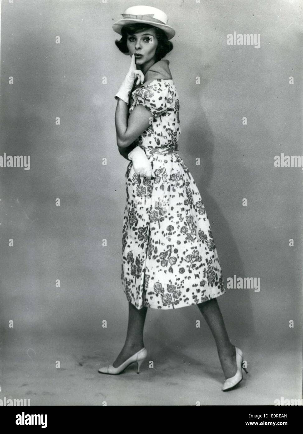 Feb. 21, 1959 - Picnic a summer dress for hot days: This summer model dress by Carven named Picnic is made of light brown printed cotton Natte and belongs to the new summer and spring fashion 1959. - Stock Image
