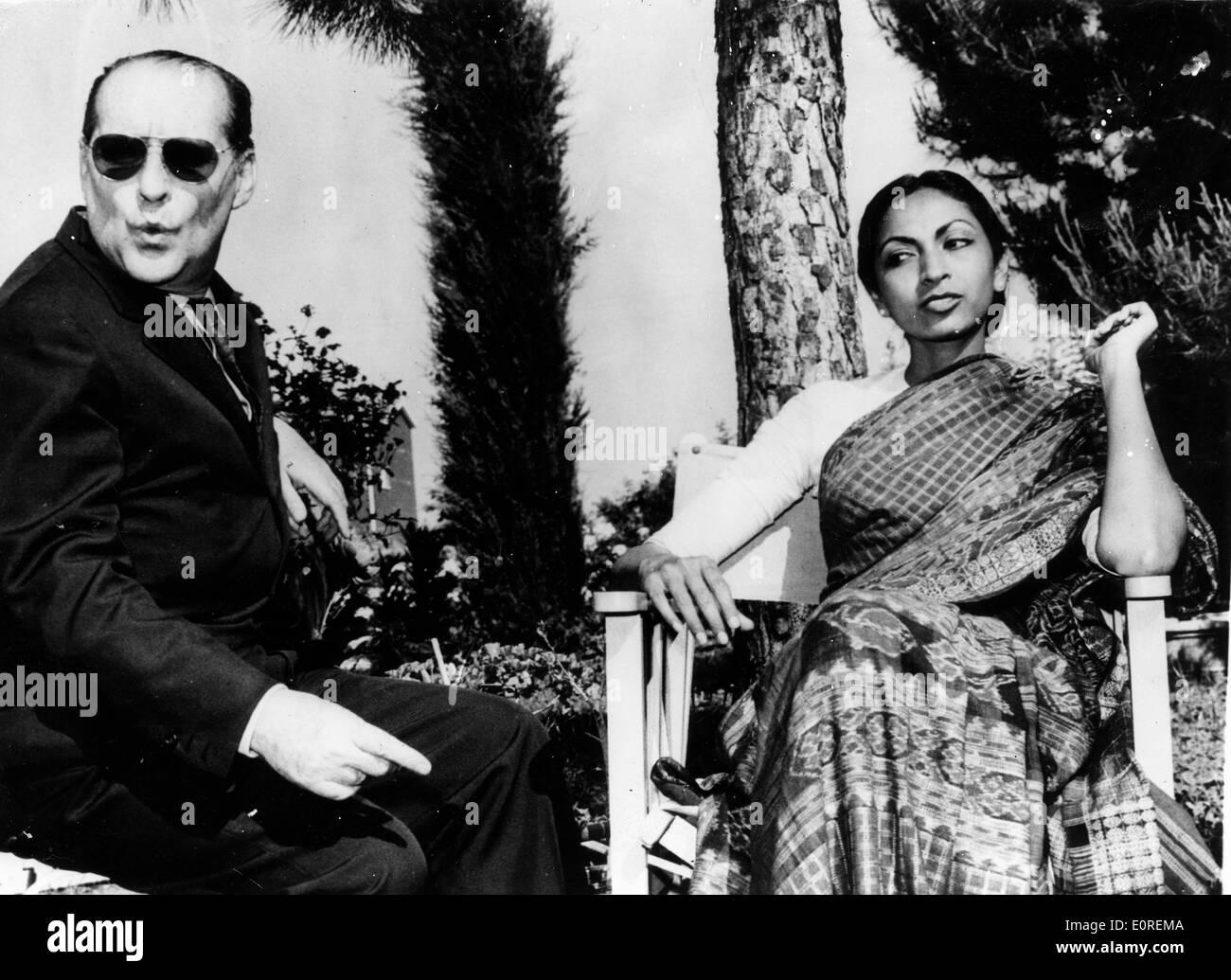 Director Roberto Rossellini seated with his wife Sonali Das Gupta - Stock Image