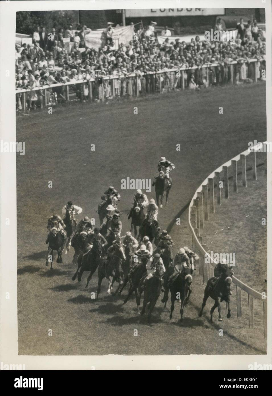 Jun. 05, 1959 - ''Parthia'' Wins The 1959 Derby Field At Tattenham Corner: The Derby was won at Epsom this afternoon by Sir Humphrey de Traffors's ''Parthia'' (Harry Carr) with ''Fidalgo'' (J. Mercer) second and ''Shantung'' (Palmer) (third). Photo shows: General view as the field rounds Tattenham corner - during the Derby this afternoon. - Stock Image
