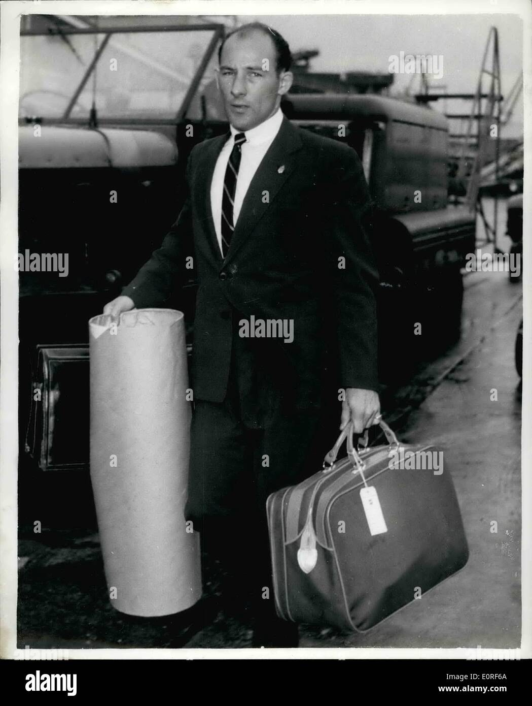 Jun. 06, 1959 - Stirling Moss ''Staggered'' by crash widow's charge: When he arrived at London Airport from Canada yesterday, racing driver Stirling Moss said was ''staggered'' when he heard of the charge of ''negligent killing'' made against him by the widow of Swiss driver Fausto Meyrat. Meyrat died in hospital from injuries received on Sunday when he crashed on the German Nurburgring in the 1,000 kilometers sports car race won by Moss in the Aston Martin. the German police are investigating an allegation that Meyrat went off the track after never know whether Meyrat touched me or not'' - Stock Image