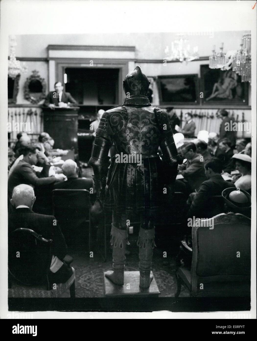 Jun. 06, 1959 - Sale of Arms and Armour at Christies suit sold for 370: A sale of the collection of Arms and Armour, formed by Folke Ellioth of Goteborg, Sweden - properties of James Christie Esq - and of the late R.W. Lloyd Esq., etc. was carried out at Christies today. One of the main items sold was a suit of Armour - one of twelve suits made for Elector Christian I of Saxony, and which was to have been presented to him on Christmas Day 1591.. The Electro died four months before - so the gift was never made.. - Stock Image