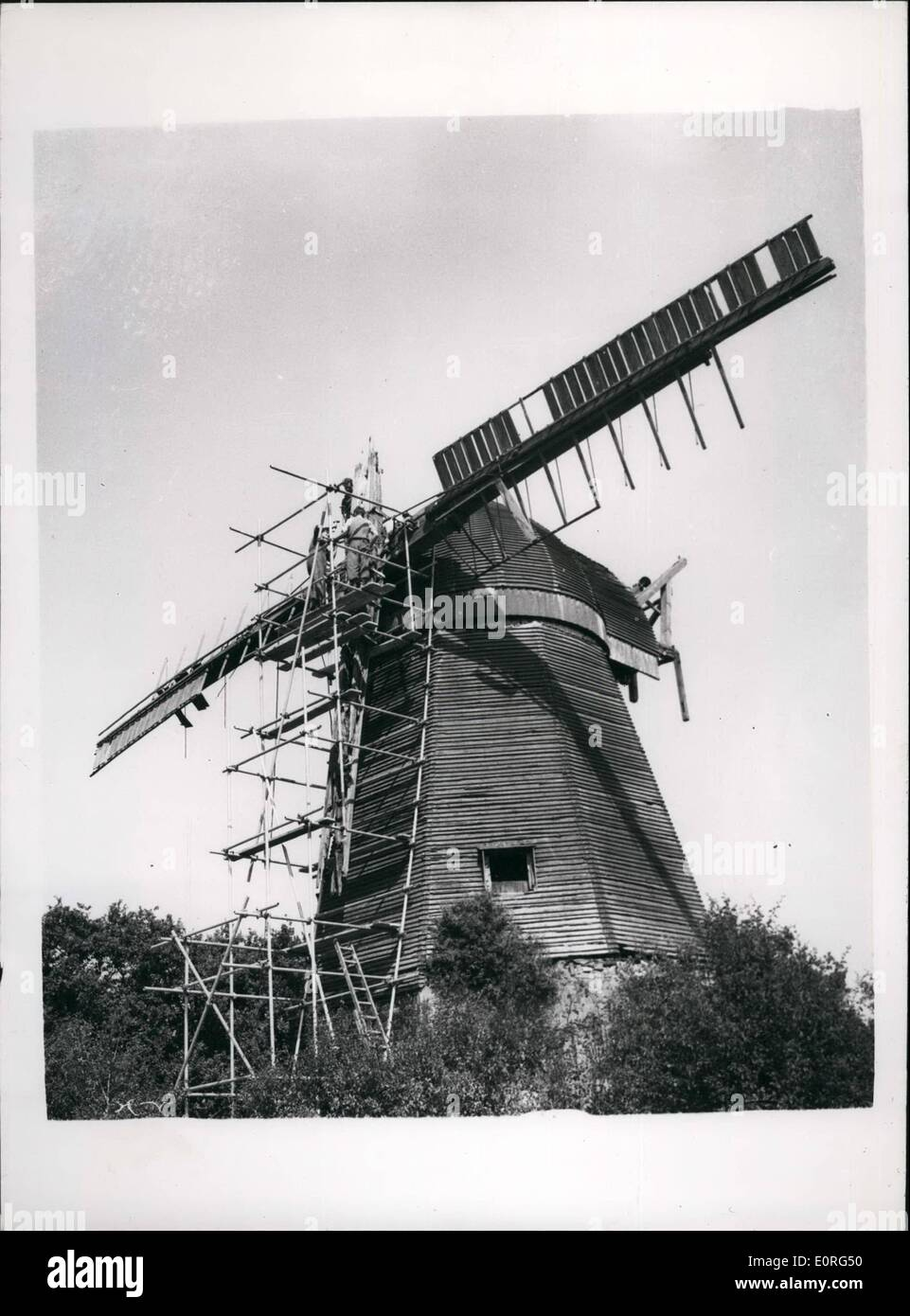 Aug. 08, 1959 - Ancient Sussex Windmill is being dismantled to be re-erected in Surrey: The famous old Jolesfield Windmill, built about 1970 at Littleworth, near Partridge Green, Sussex is now being dismantled, despite protests from residents. The 170-year-old mill, a smock mill (one in which the cap and sails only revolve) is to be re-erected and restored to full working order in the grounds of the 13th century Gatwick Manor, on the London to Brighton road. Mr Edwin Hole, who is one of Britain's few remaning millwrights, is in charge of teh dismantling operations. Mr - Stock Image
