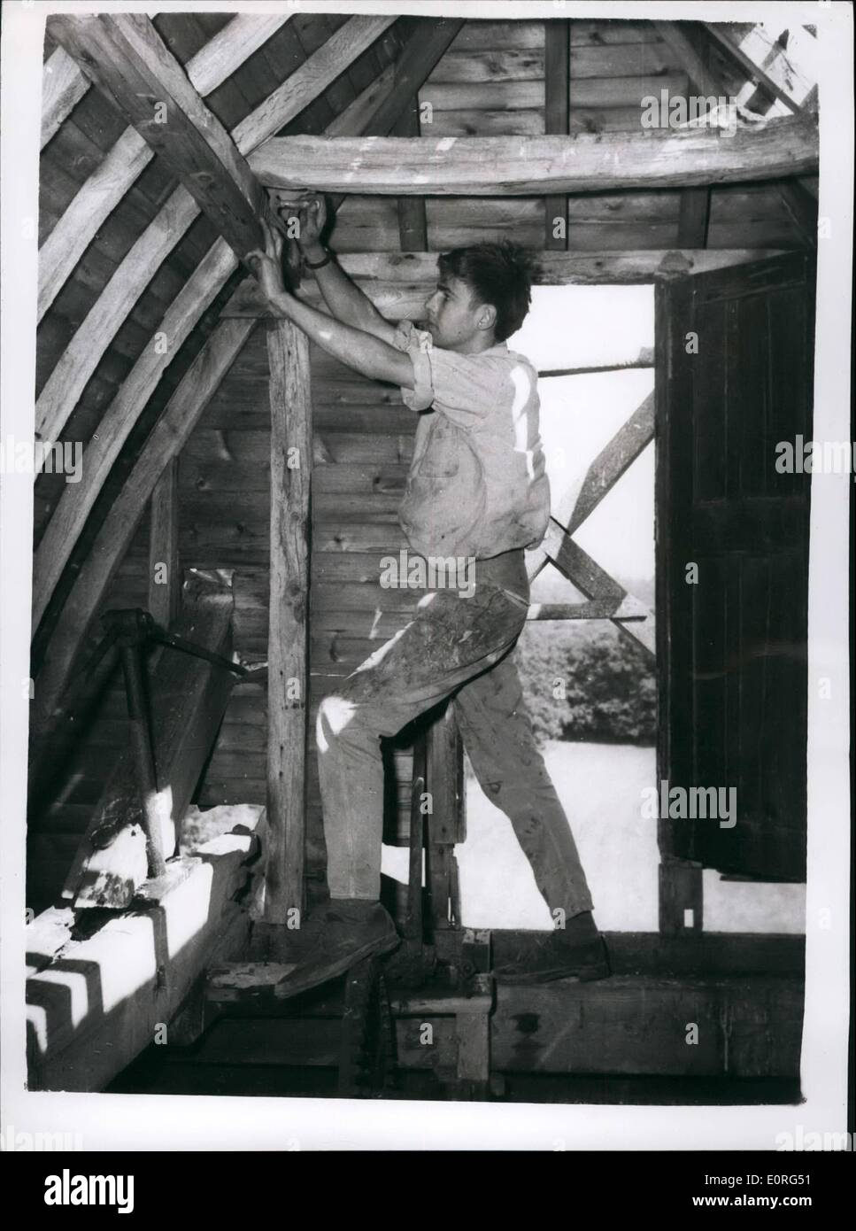 Aug. 08, 1959 - Ancient Sussex Windmill is being dismantled to be re-erectd in Surrey: The famous old Jolesfield Windmill, built about 1790 at Littleworth, near Partridge Green, Sussex, is now being dismantled, despite protests from residents. The 170 year old mill a smock mill (one in which the cap and sails only revolve) is to be re-erected and restored to full working order in the grounds of the 13th century Gatwick Manor, on the London to Brighton road. Mr. Edwin Hole, who is one of Britain's few remaining millwrights, is in charge of the dismantling operaions, Mr - Stock Image