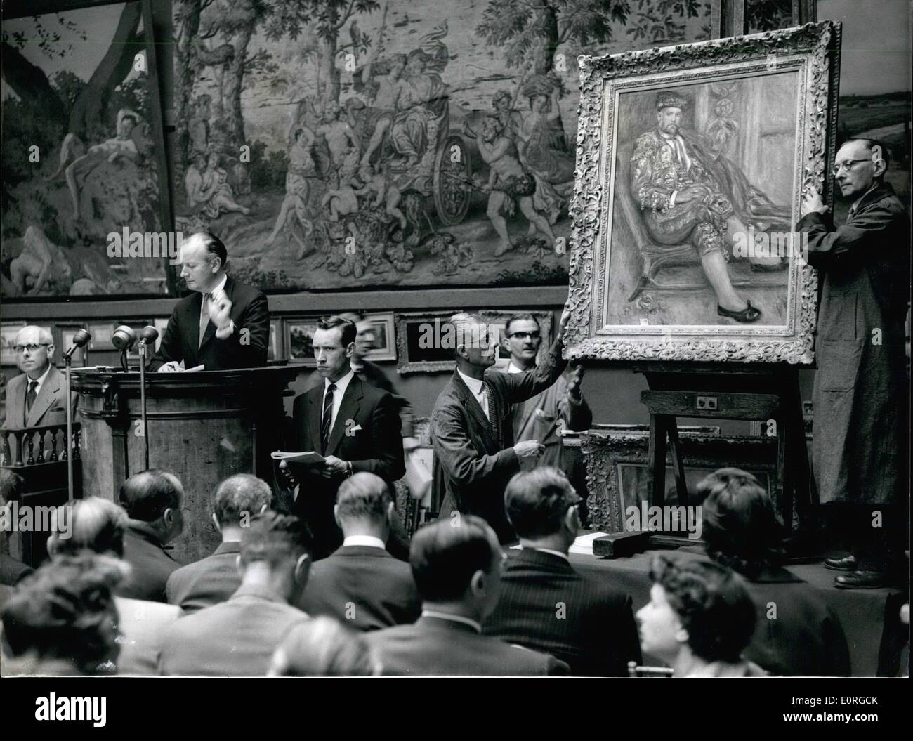 Jul. 07, 1959 - Paintings From Chrysler Collection - Sold in London Renoir Brings. £22,000 ...A number of painting from the fabulous collection belonging to American millionaire Walter P. Chrysler Jnr. were put up for auction at Sotheby's this morning. Photo shows: Scene during the sale of ''Portrait D'Ambroise Vollard an Toreador'' - by Pierre-Auguste Renoir - dated 1917. It went for £22,000 - Stock Image