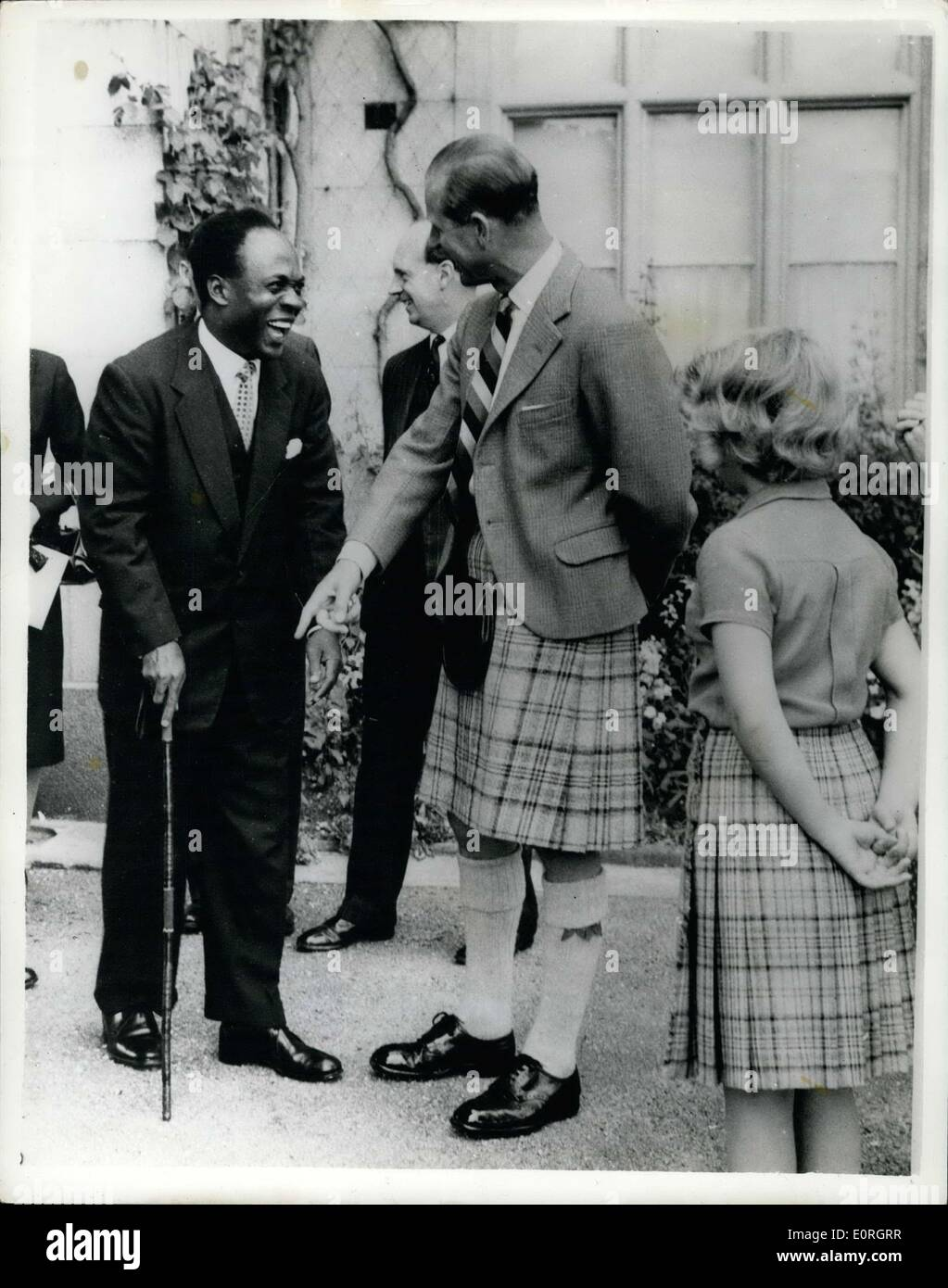 Aug. 13, 1959 - The Queen Honours The Man Who Kept Her Secret Ghana's Prime Minister Visits Her At Balmoral: Dr. Nkrumah, the Prime Minister of Ghana, paid a visit to the Queen ay Balmoral Castle yesterday to discuss plans and a new date for the royal visit to Ghana, which was cancelled because of the Queen's pregnancy. During his stay as guest of the Queen Dr.Nkrumah was made a Privy Councillor. Photo Shows Prince Philip has a joke with Dr.Nkrumah about his walking-stick at Balmoral yesterday, watched by Princess Anne. - Stock Image