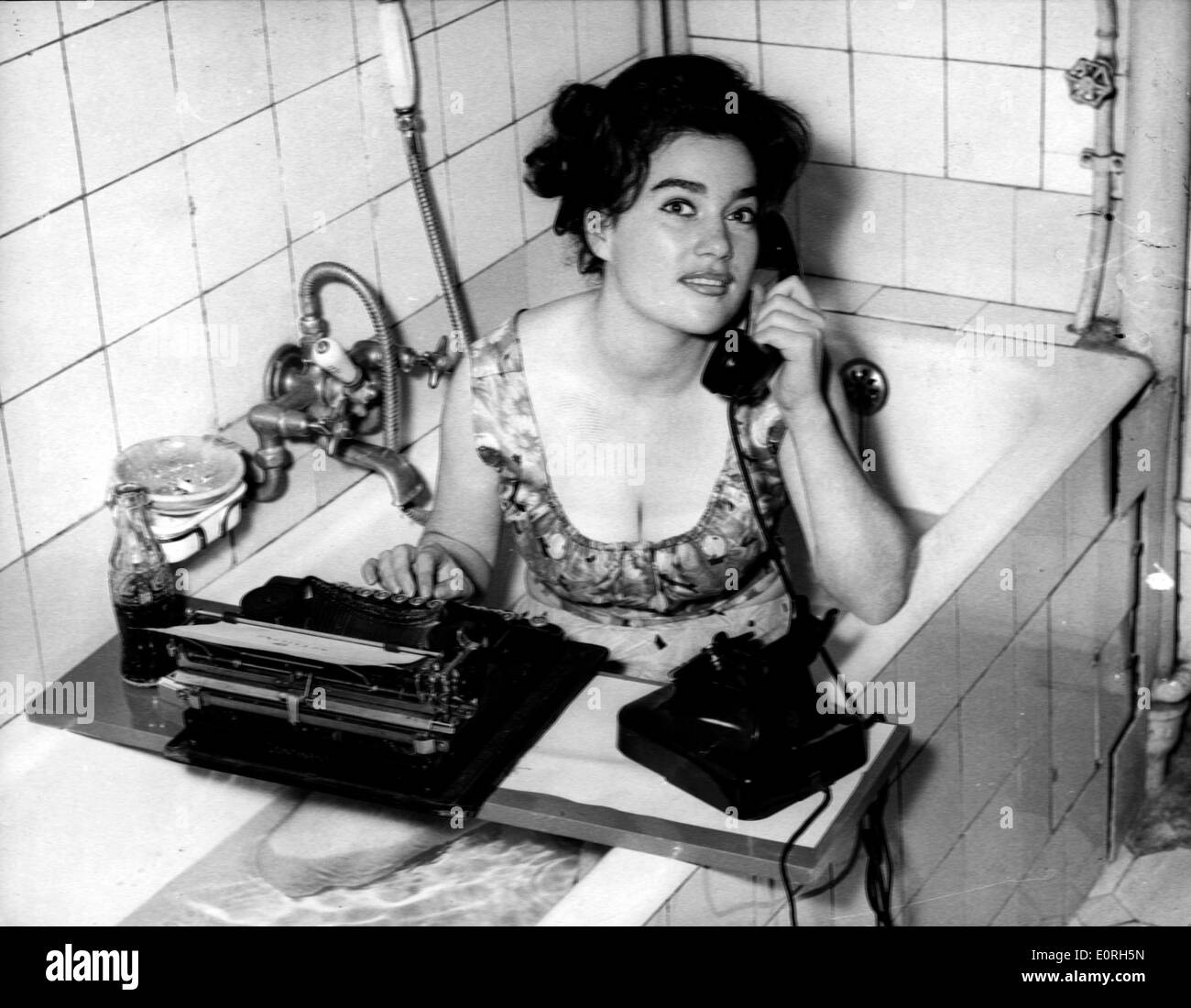 A German woman who has set up an office in the bathtub Stock Photo ...