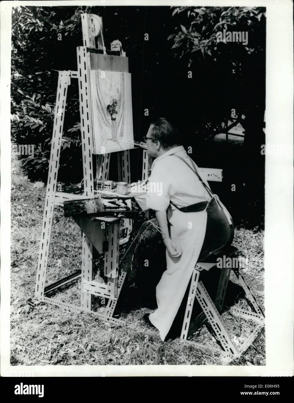 Sep. 09, 1959 - Unique Easel helps crippled artists.: Albert Baker a patient at Le Court, Liss, Hampshire, a Cheshire Foundation Home has struggled for some years to become a successful artist. Unable to use his hands he has trained himself to hold a paint brush with his teeth - but until recently his problems were to great - for he could neither stand or sit more than a few minutes at a time without suffering intense pain - and he could not reach all parts of the canvas without having someone to move it - Stock Image