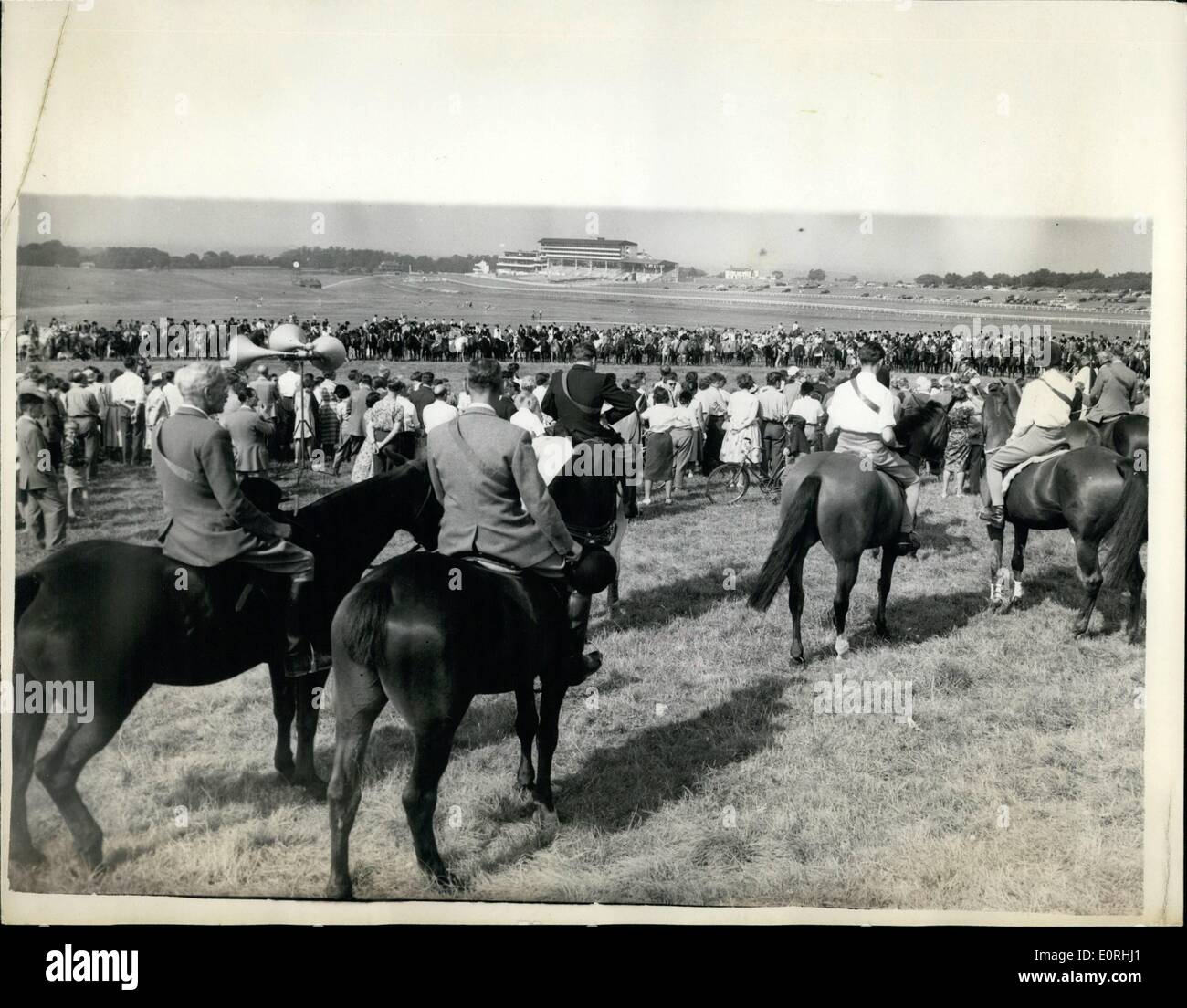 Sep. 09, 1959 - Horseman's Sunday Service At Epsom Downs: About six hundred riders took part in the annual Horseman's Sunday service held at Tattenham Corner on Epsom Downs today. The service was conducted by the vicar of Burgh Heath, and the Bishop of Guildford, the Rt. Rev. Dr. Ivor Watkins made an address and blessed the gathering. Photo shows T A general view during the service at Tattenham Corner on Epsom Downs today. The racecourse grandstand can be seen in the background. - Stock Image