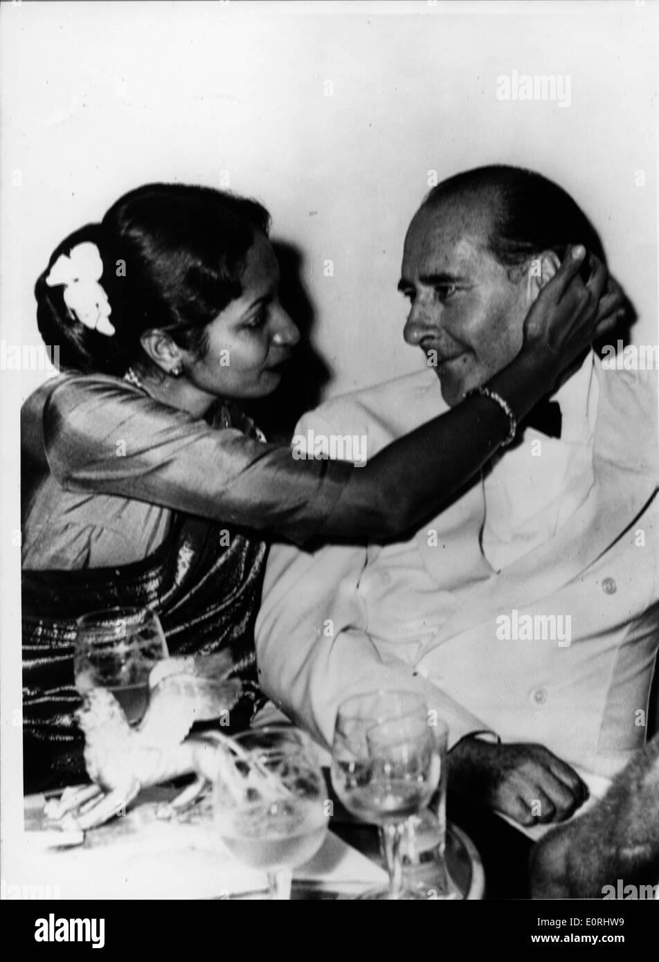 Director Roberto Rossellini at dinner with wife Sonali Das Gupta - Stock Image