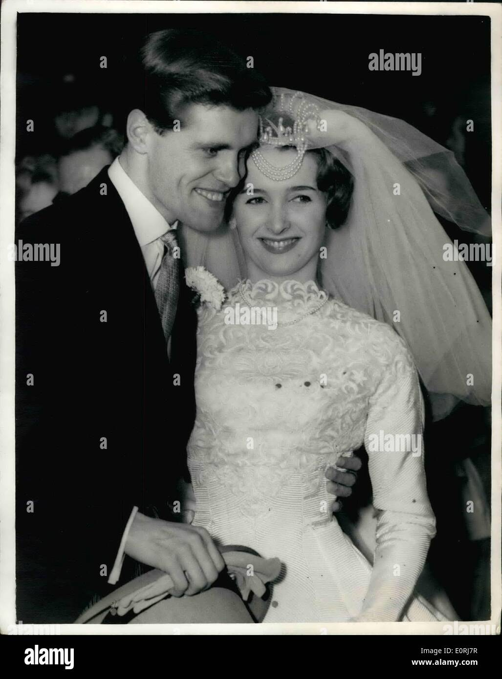 Oct. 10, 1959 - Ronnia Carroll weds musical comedy star: The wedding took place today at Holy Trinity Paddington of actress Musical Comedy star Millicent Martin of ''The Crocked Mile'' at the Cambridge Theatre to singer Ronnie Carroll. The bride was given away by her agent John Penrose and her bridesmaid was her ten year old sister Christine. Photo shows the Bridge and Bridegroom after the wedding this afternoon. - Stock Image