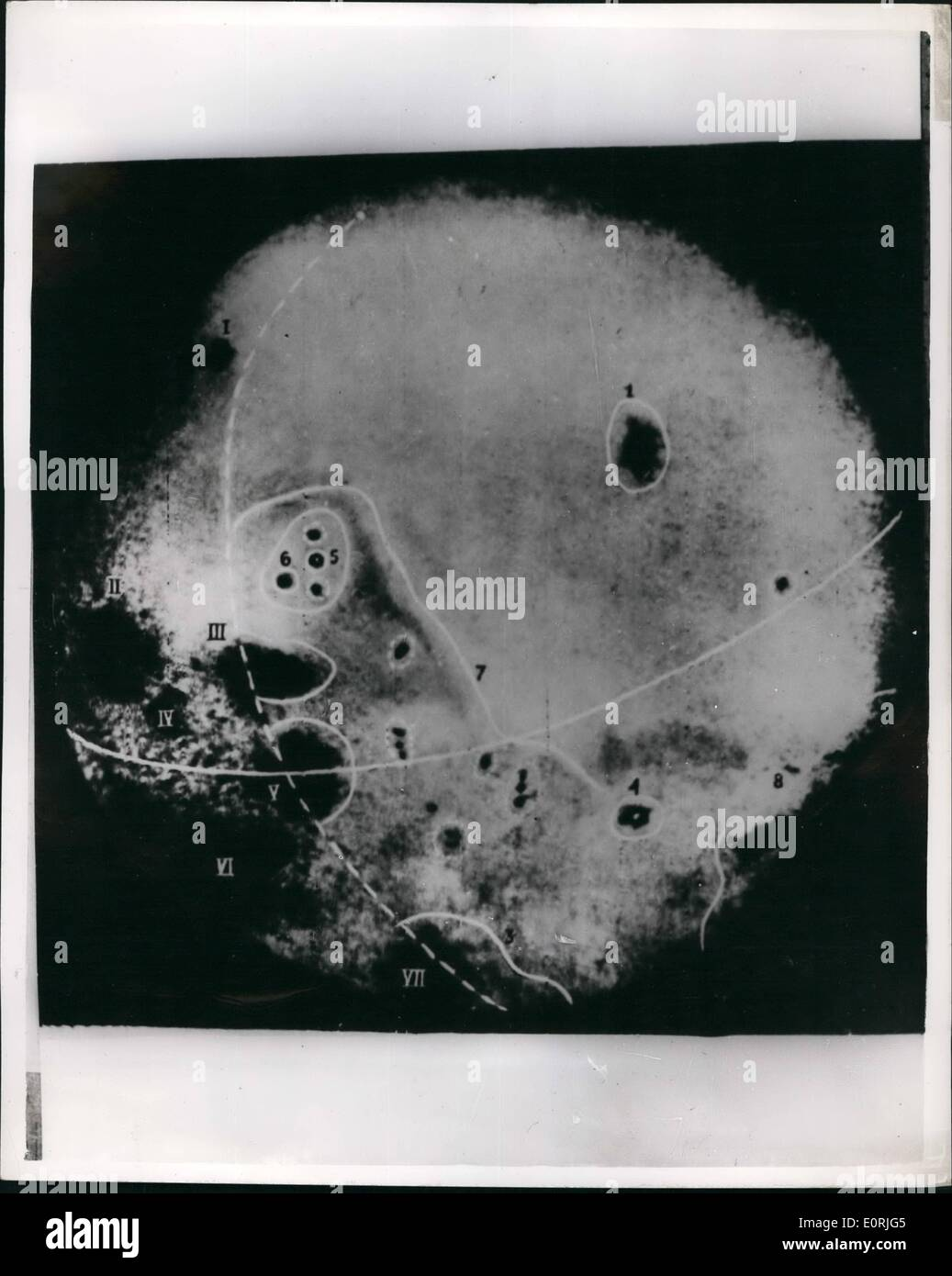 Oct. 10, 1959 - Moscow releases amazing picture of the Moon: Moscow yesterday released this amazing photograph of the other side of the moon based on pictures televised back to the Earth from cameras in the rocket Lunik III, with the following explanations. Situation of objects on Moon's reverse side as revealed in preliminary processing of photographs received from automatic interplanetary station. (1) Large 300 km. in diameter sea crater. Moscow Sea. (2) Astronauts Bay of Moscow Sea. (3) Continnation of South Sea on Moon's reverse side. (4) Crater of main Tziolkevsky Hill - Stock Image