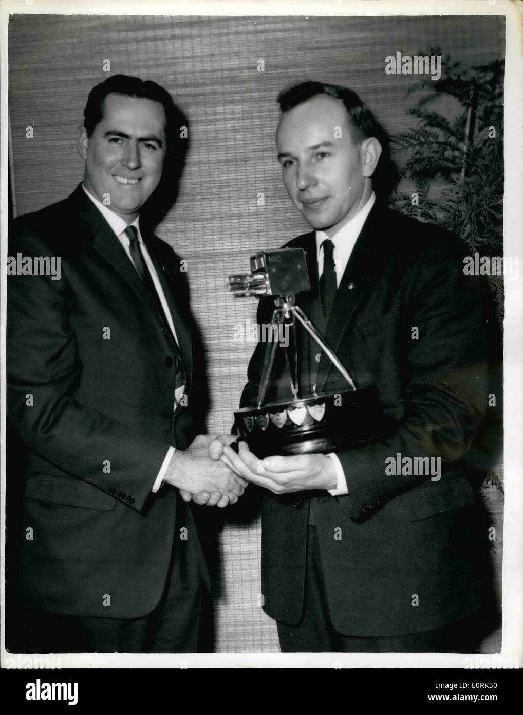 Dec. 12, 1959 - John Surtees is chosen as TV's Sportsman of the Year: John Surtess the fastest man in the world on motorcycle was last night chosen as Sports Personality of 1959 by B.B.C. Television's Sportsview Surtess world motor-cycling champion for the year in succession, was presented with the trophy. a miniature television camera. by Sir John Hunt, of Everest fame. Photo shows two speed champions meet for mutual congratulations - Stock Image