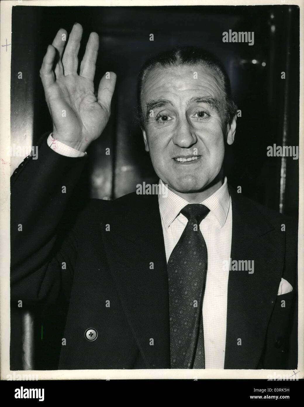 Dec. 12, 1959 - The Minister of Transport leaves for New York. He is to Study American traffic problems.: Mr. Ernest Marples the Minister of Transport left Waterloo Station this afterno aboard the Queen Elizabeth Boat Train for New He is going to study the New York Traffic proble soloutions. Photo shows Mr. Ernest Marples waves when he left waterloo this afternoon. - Stock Image