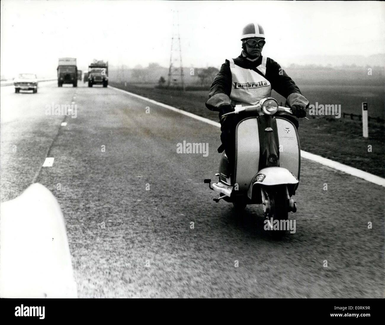 Nov. 02, 1959 - Lambretta covers 142 miles in 143 minutes on the new motorway: Brian Gibbs, works rider for Lambretta, took a spare part to the Birmingham and of the new motorway opened todya the M.1 from Luton Spur, where the opening took place and returned after refuelling to the St. Albans' and of the M.1. He covered the total of 142 miles in 143 minutes. Photo shows Brian Gibbs seen riding the Lambretta to Birmingham on the M.1. today. - Stock Image