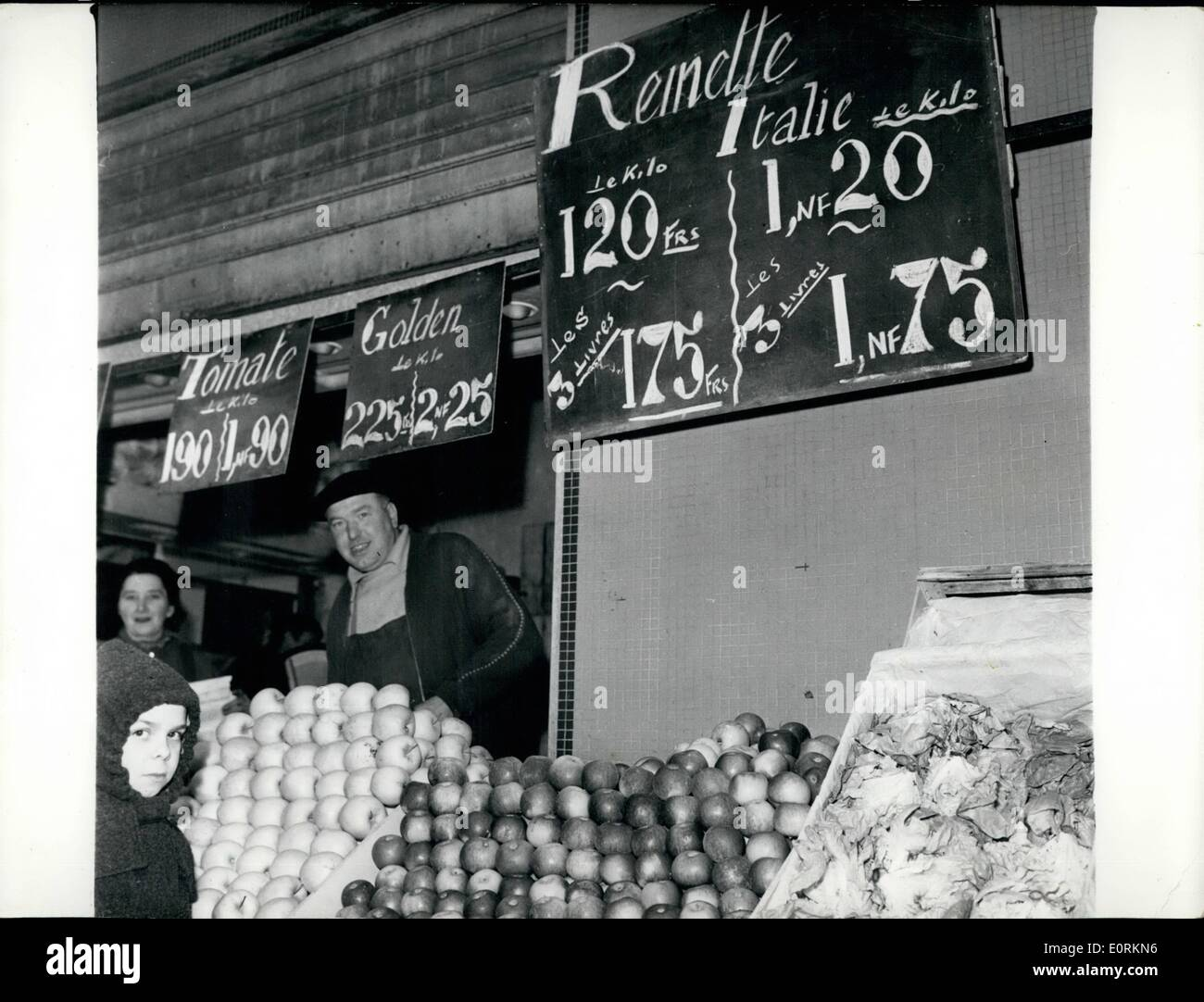 Jan. 01, 1960 - 'Heavy Franc'' becomes effective: The New ''Heavy Franc'' has become effective in France from January the 1st. all prices must now be quoted accordingly. The new Banknotes and coins will be put int circulation he progressively during the year. photo shows Paris shops displaying labels with indicating prices in old and new francs (the new heavy France is worth loo old ''light Francs' - Stock Image