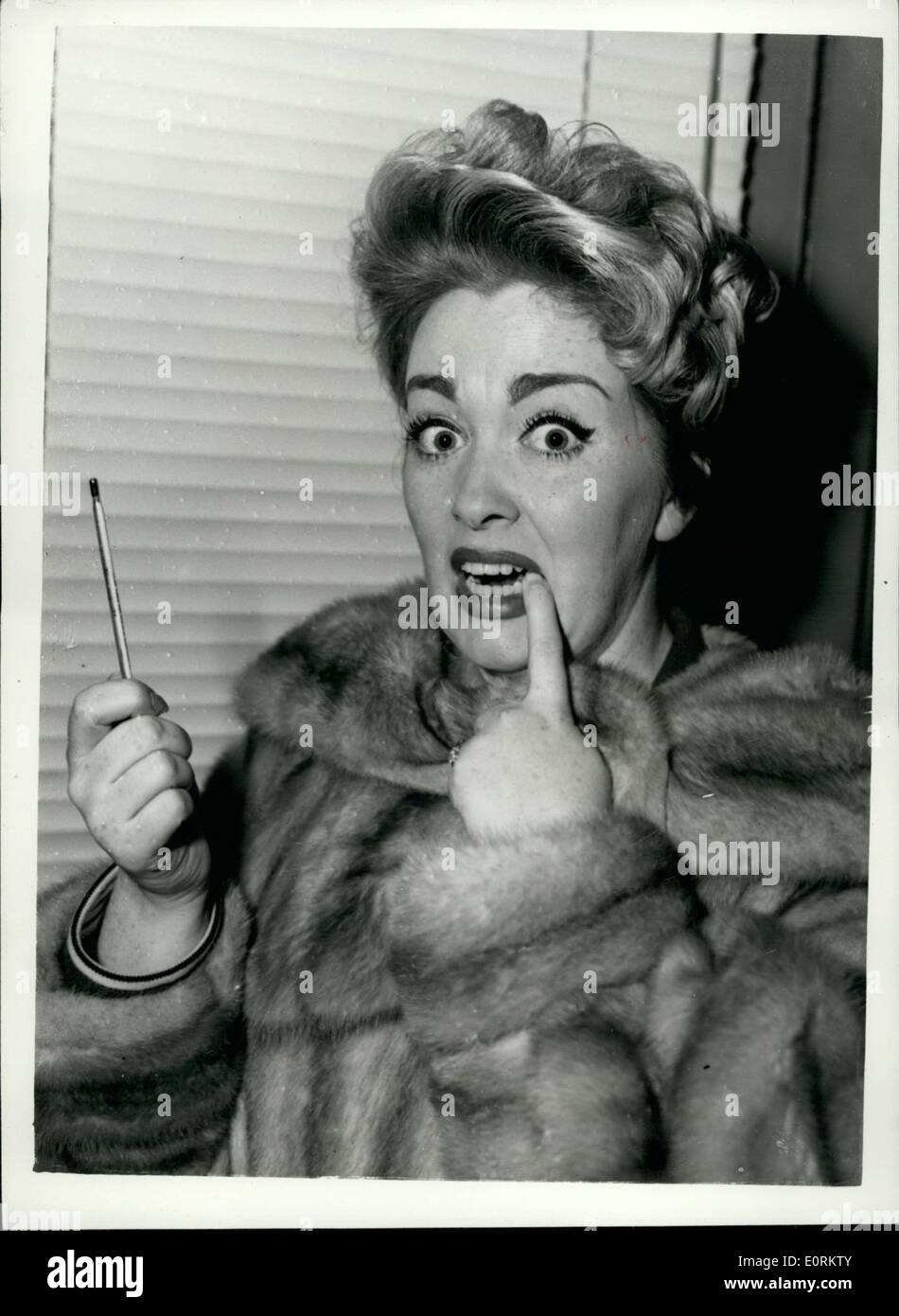 Jan. 01, 1960 - Reception for Marion Ryan. A press reception was given in London today to popular singer Marion Ryan, who has joined E.M.I. Records. Marion, she has starred in the Granada Network T.V. Production Spot the Tune wince its inception four years ago will record for the Columbia label. After tonight's Spot the Tune performance she will be rushed to the Harley Street Nursing Home for an appendicitis operation. Keystone Photo Shows: Marion Ryan looks surprised at the temperature reading when she took her temperature at today's reception. H/Keystone - Stock Image