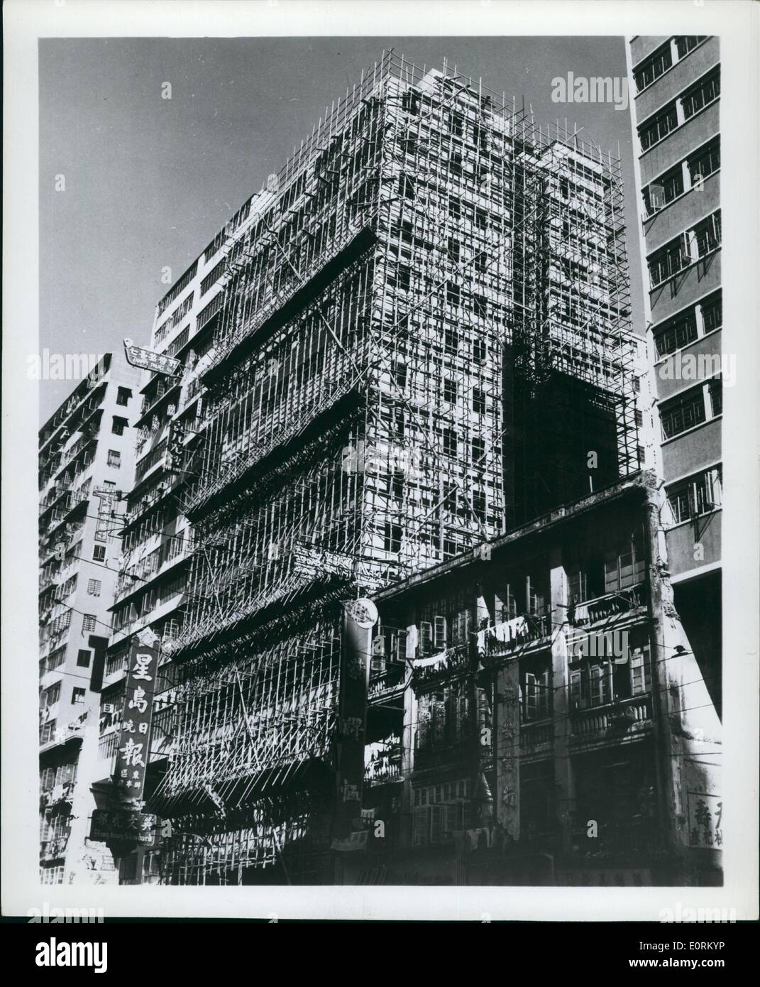 Jan 1, 1960 - Here's How -- A bamboo scaffold covers a new building rising on Hong Kong's Nathan Road. Proving stronger than steel for this purpose, the unusual method is the popular one in the British Crown Colony. - Stock Image