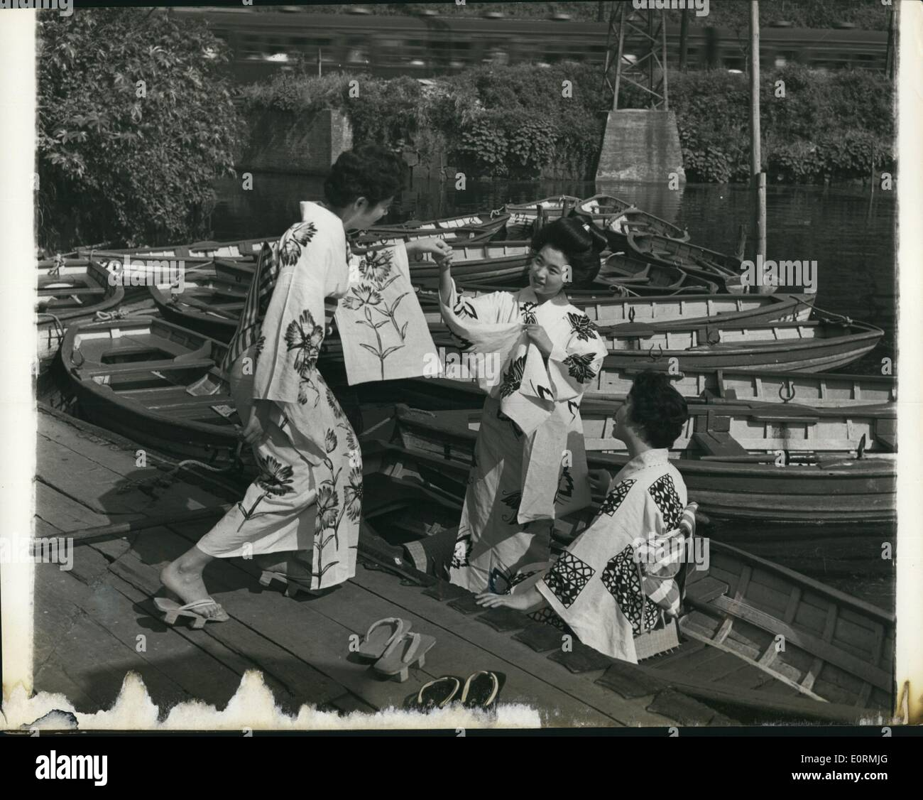Jan 1, 1960 - Geishas off duty. Before the evening's entertainment starts, the Geisha girls wearing simple Kimonos Stock Photo