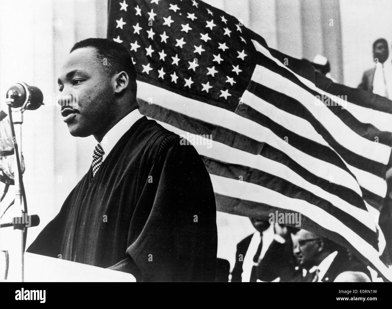 Minister Martin Luther King, Jr. preaching at an event - Stock Image