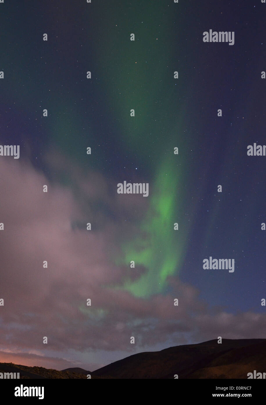 Clouds and Aurora Borealis above the Northern Lights Inn, near Grindavik, iceland - Stock Image